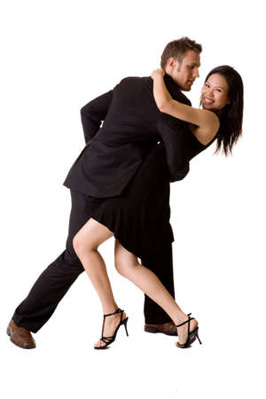 young couple in black attire dancing happilly
