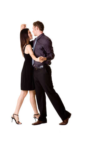 young couple in black attire dancing happilly photo