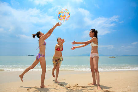 grilfriends playing a bach ball on a beatiful day Stock Photo - 3673122