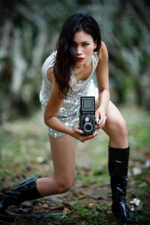 goth girl holding a twin lens reflex camera Stock Photo - 3673119