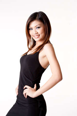 beautiful asian woman in a little black dress Stock Photo