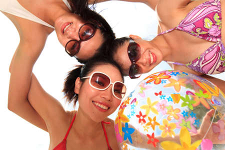 three happy girls friends at the beach on a beautiful day Stock Photo - 3697586
