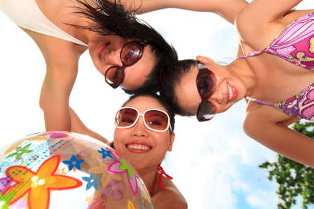 three happy girls friends at the beach on a beautiful day Stock Photo - 3697557