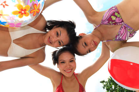 three happy girls friends at the beach on a beautiful day Stock Photo - 3697569