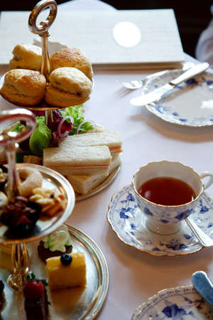 afternoon tea: english high tea setting with bread, scones and such Stock Photo