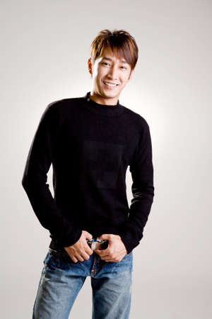 asian young handsome man with friendly smile in casual wear
