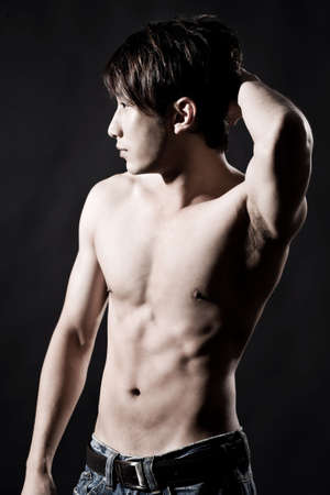 body profile of a muscular hunky asian man photo