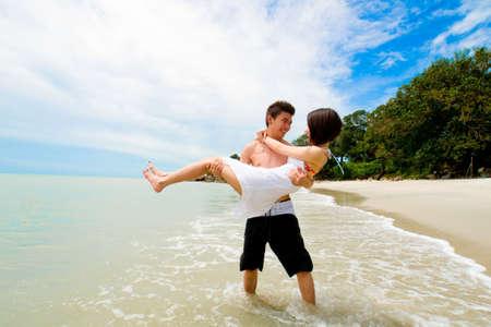 happy couple having fun at the sunny beach