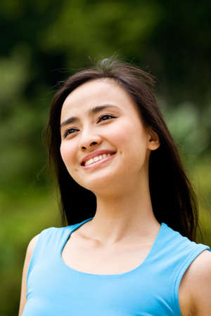 pretty smile asian woman enjoying the outdoor nature view
