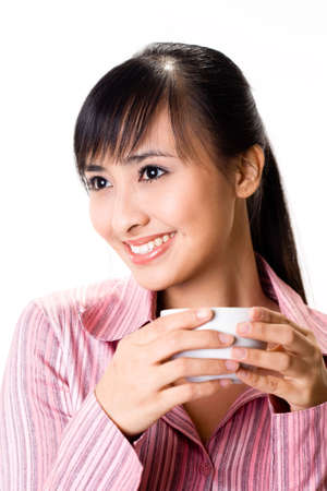 asian businesswoman drinking a cup of tea photo