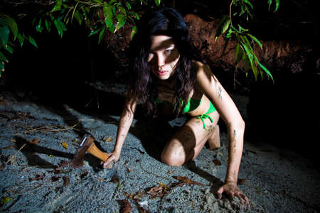 feroz: fierce asian woman crawling in the tropical green forest environment