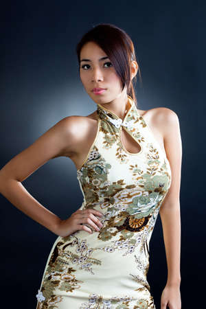 asian young woman wearing traditional chinese dress cheong sam