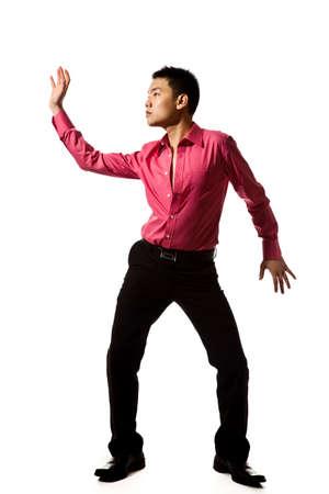 affectionate action: estilo asi�tico joven con camisa de color rosa en la acci�n plantean Foto de archivo