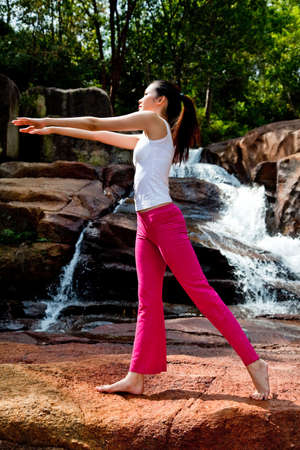 outdoor waterfall young woman stretching her body Stock Photo - 4344941