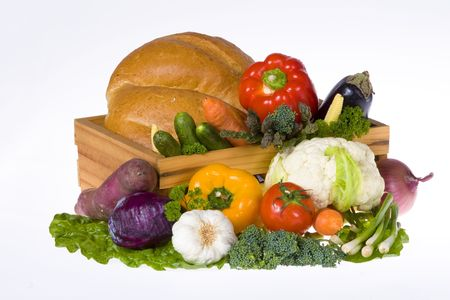 Assortment of bread, vegetables and herbs isolated on white photo