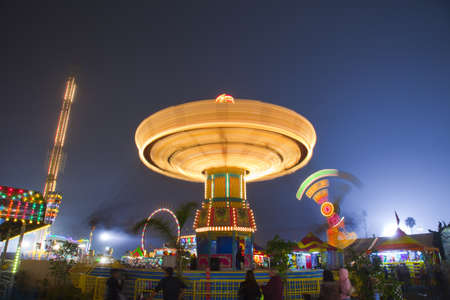 View looking up at the carousel swing ride  Carnival Midway at night