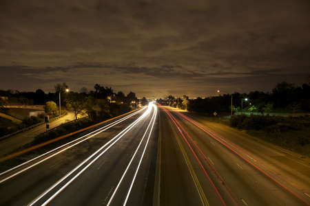 streaking: West Los Angeles skyline at night with traffic streaking by on the 405 freeway.  Stock Photo