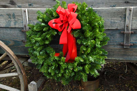 Christmas Wreath on an old Farm Wagon