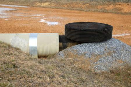 Overflow Drain in Retention Pond Stock Photo