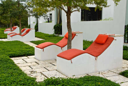 Outdoor Chaise Lounges at a Vacation Resort Фото со стока