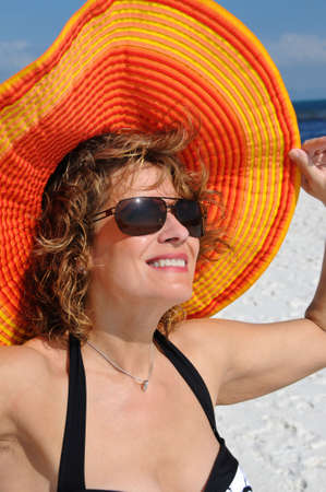 Attractive Woman Wearing a Bright Summer Hat Stok Fotoğraf