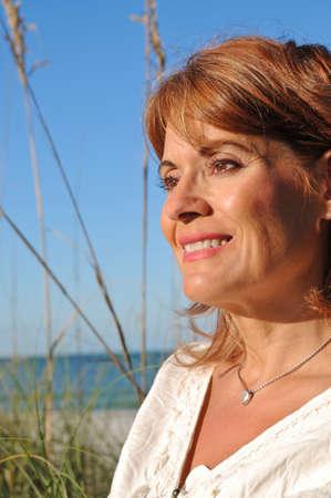 Aantrekkelijke Vrouw op het strand Stockfoto