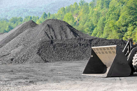 Stockpile of Coal with Loader Stock Photo