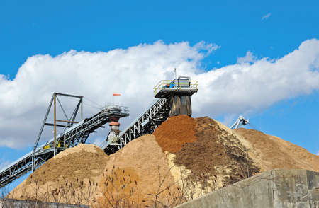 Conveyor Dumping Wood Chips and Biomass in a Pile at a Paper Mill