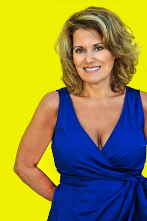 Attractive Mature Woman against Bright Color Wall Reklamní fotografie - 28042216