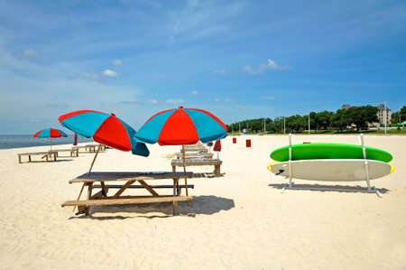 Colorful Beach Umbrella and Sun Bathing Deck on the Beach Banco de Imagens