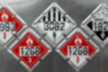 Blur Image - USDOT Hazardous Materials Transportation Placards on rear of a Fuel Tanker