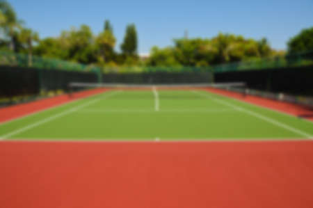新しいテニスコートの背景イメージをぼかします。 写真素材