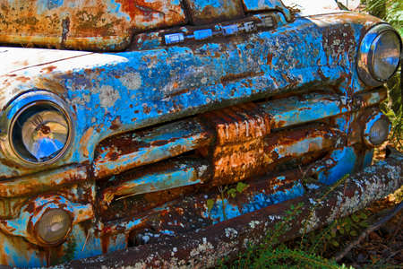 White, GA / USA - October27, 2018 - Close up Image of the Front of an Old Rusted Dodge Truck in a Junk Yard
