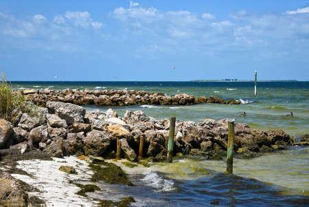 Rock Jetties on Anna Maria Island Beach to minimize beach erosion from rising tides Stock Photo