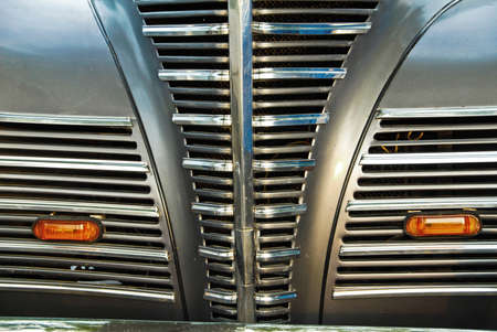 Close up view of an Old Car's Front Grill