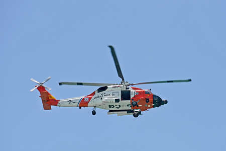 Anna Maria Island, FL / USA - May 2, 2018: U.S. Coast Guard Helicopter flying over the Florida Coastline on a Summer Day