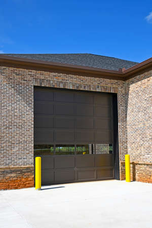 A Large Garage Door Installed on a New Commercial Building
