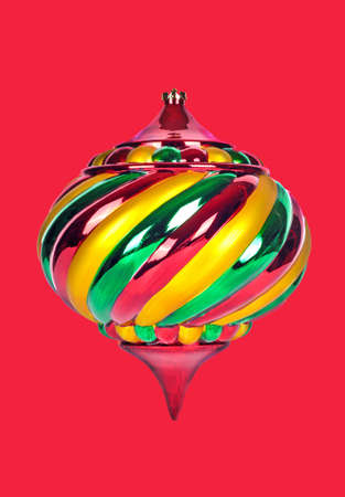 A Beautiful and Colorful Christmas Ornament Isolated on a Red Backgound 版權商用圖片