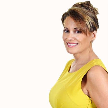 Portrait of a Beautiful Mature Woman Wearing a Yellow Dress