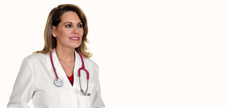 A Beautiful Female Doctor in a White Lab Coat with a Stethoscope around her Neck. 版權商用圖片