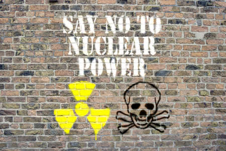 Say no to nuclear power sprayed on brick wall Stock Photo - 9126422