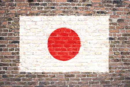 Japanese flag sprayed on brick wall Stock Photo - 9126428
