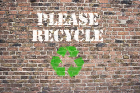 Please Recycle sprayed on brick wall photo