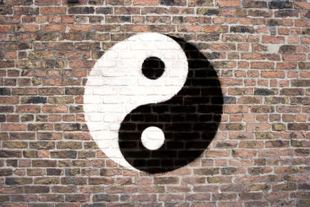 sprayed: Yin and Yang symbol sprayed on brick wall Stock Photo