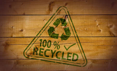 100 Percent Recycled stamp on wooden background Stock Photo - 10412460