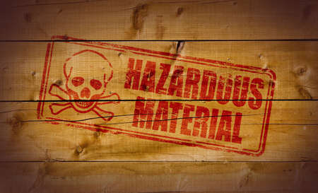 Hazardous Material stamp on wooden background Stock Photo - 10412464