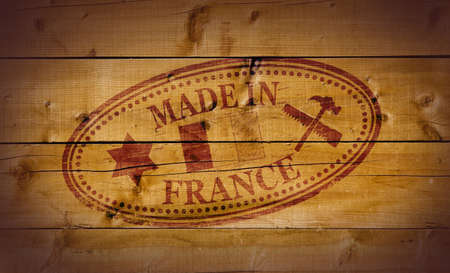 Made in France stamp on wooden background Stock Photo - 10412461