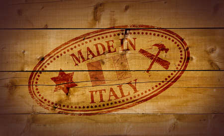 Made in Italy stamp on wooden background Stock Photo - 10412468