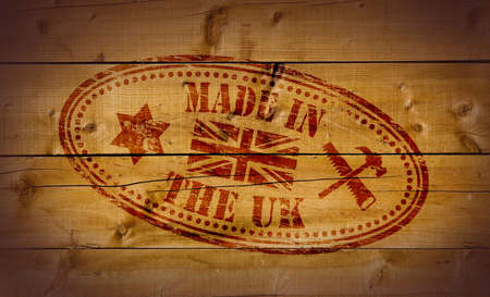 Made in The UK stamp on wooden background Stock Photo - 10412469