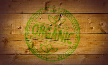 Organic stamp on wooden background Stock Photo - 10412450